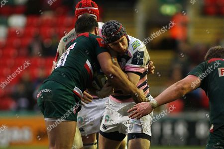 Rhuan Williams of Cardiff Blues is tackled by Gareth Owen of Leicester Tigers