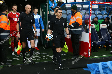 Referee Neil Swarbrick leads out the sides