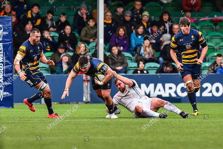 Ethan Waller of Worcester Warriors is tackled by Moray Low of Exeter Chiefs