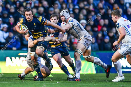 Anton Bresler of Worcester Warriors is tackled by Moray Low and Toby Salmon of Exeter Chiefs
