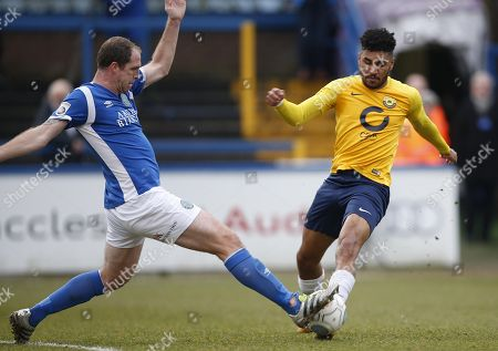 Torquay United player Jamie Reid is tackled by Macclesfield Town player Keith Lowe during the Vanarama National League Match between Macclesfield Town and Torquay United at Moss Rose, Macclesfield on January 27.