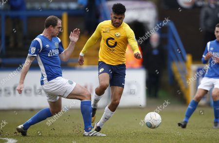 Macclesfield Town player Keith Lowe tackles Torquay United player Jamie Reid during the Vanarama National League Match between Macclesfield Town and Torquay United at Moss Rose, Macclesfield on January 27.