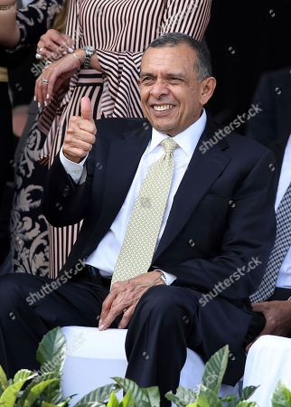 Former Honduran President Porfirio Lobo Sosa gives a thumbs up during the presidential inaugural ceremony for Juan Orlando Hernandez, at the National Stadium in Tegucigalpa, Honduras, . The opposition does not recognize Hernandez's victory following disputed poll results, and has been protesting ahead of his Jan. 27 swearing-in ceremony