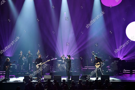 Drew Brown, Tim Meyers, Eddie Fisher, Ryan Tedder, Brent Kutzle, Zach Filkins. Drew Brown,from left, Tim Meyers, Eddie Fisher, Ryan Tedder, Brent Kutzle and Zach Filkins of OneRepublic perform onstage at the 2018 MusiCares Person of the Year tribute honoring Fleetwood Mac at the Radio City Music Hall on in New York
