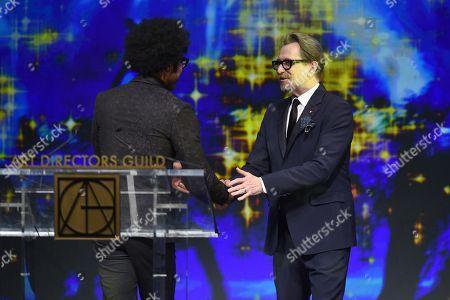 Johnathan Fernandez and Gary Oldman