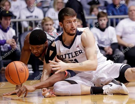 Marvin Clark II, Nate Fowler. Butler center Nate Fowler, right, and St. John's forward Marvin Clark II (13) go to the floor for a loose ball in the first half of an NCAA college basketball game in Indianapolis