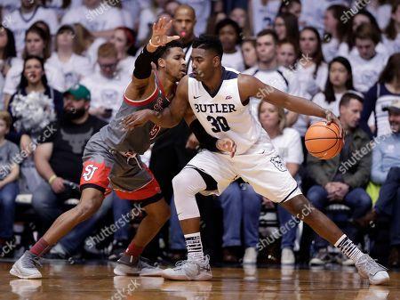 Justin Simon, Kelan Martin. Butler forward Kelan Martin (30) drives against St. John's guard Justin Simon (5) in the second half of an NCAA college basketball game in Indianapolis