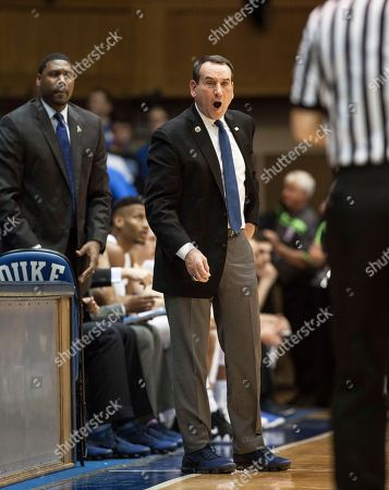 Mike Krzyzewski, Nate James. Duke Head Coach Mike Krzyzewski, right, shouts toward an official as Assistant Coach Nate James, left, looks on during the second half of an NCAA college basketball game against Virginia in Durham, N.C., . Virginia defeated Duke 65-63