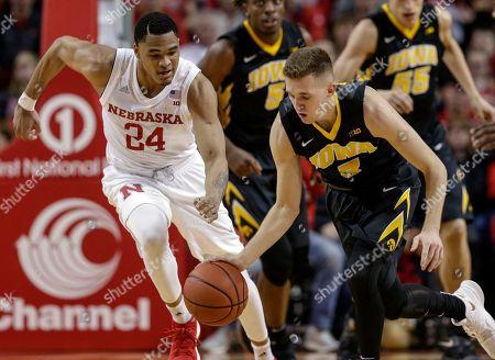 Jordan Bohannon, James Palmer Jr. Iowa's Jordan Bohannon (3) and Nebraska's James Palmer Jr. (24) chase the ball during the second half of an NCAA college basketball game in Lincoln, Neb., . Nebraska won 98-84