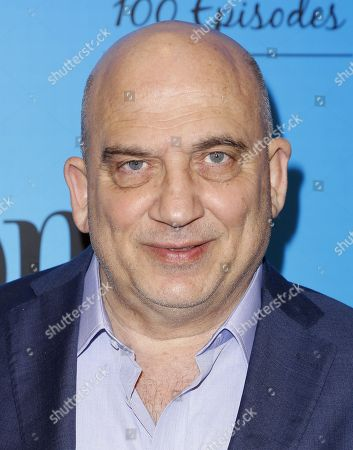 """Stock Picture of Jonny Coyne arrives at the """"Mom"""" 100th Episode Celebration, in Los Angeles"""