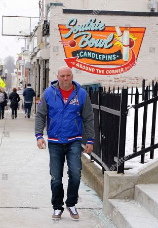 "Stock Photo of Dana White, president of the Ultimate Fighting Championship, the largest mixed martial arts organization in the world, walks along Broadway by the old Courthouse in the ""Southie"" neighborhood of Boston. Long before he ran the UFC White was a ""Southie"" trying to make his way in boxing who dodged the money collectors for notorious crime boss Whitey Bulger that came knocking at his door"