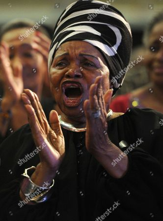 """A woman sings and dances during a memorial service for South African Jazz legend, Hugh Masekela, in Johannesburg, . The son of legendary South African jazz musician and anti-apartheid activist Hugh Masekela says his father had """"laughter and humor to the very end"""" before his death this week in Johannesburg"""