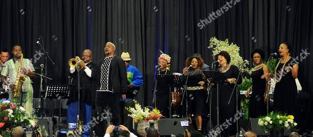 """Musicians perform at a memorial service for South African Jazz legend, Hugh Masekela, in Johannesburg, . The son of legendary South African jazz musician and anti-apartheid activist Hugh Masekela says his father had """"laughter and humor to the very end"""" before his death this week in Johannesburg"""