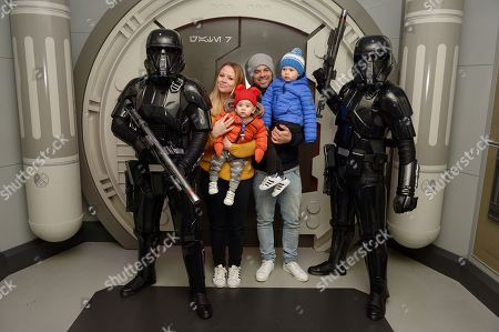 Kimberley Walsh, Justin Scott, Bobby Scott and Cole Scott pose with Elite Troopers during Season of the Force at Disneyland Paris.