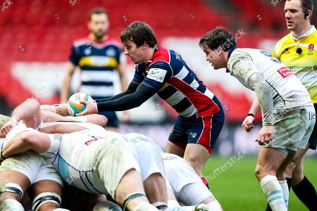 Rhodri Williams of Bristol Rugby in action as Lee Dickson of Bedford Blues looks on