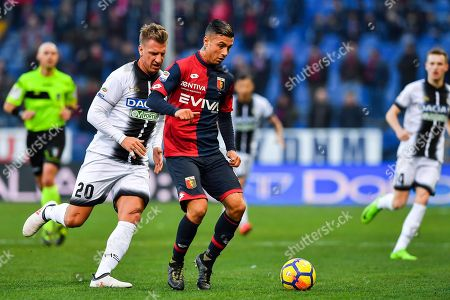 Udinese's Maxi Lopez (L) and Genoa's  Armando Izzo in action during the Italian Serie A soccer match between Genoa CFC and Udinese Calcio at Luigi Ferraris Stadium in Genoa, Italy, 28 January 2018.