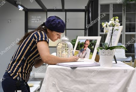 Tove Laxvik, an IKEA employee, signs a book of condolences at the entrance of an IKEA store in Stockholm, Sweden, 28 January 2018. Ingvar Kamprad, the founder of Swedish multinational furniture retailer IKEA has died at the age of 91.