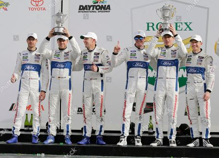 Sebastien Bourdais, Dirk Mueller, Joey Hand Scott Dixon, Richard Westbrook, Ryan Briscoe. Ganassi Race team drivers, from left, Sebastien Bourdais, of France, Dirk Mueller, of Germany, Joey Hand, Scott Dixon, of New Zealand, Richard Westbrook, of Great Britain and Ryan Briscoe, of Australia hold up their trophies after placing in the top two spots in the GT LeMans class at the IMSA 24-hour auto race at Daytona International Speedway, in Daytona Beach, Fla