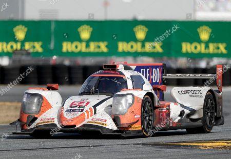 Romain Dumas, of France, drives through a turn in his ORECA LMP2 the IMSA 24-hour auto race at Daytona International Speedway, in Daytona Beach, Fla
