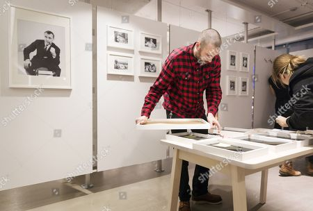 Employees hang pictures of Ingvar Kamprad, founder of Swedish multinational furniture retailer IKEA, in the entrance of the IKEA museum in Almhult, Sweden, 28 January 2018. Kamprad has died at an age of 91. The first ever IKEA store was opened in Almhult, and Kamprad grew up in the area.