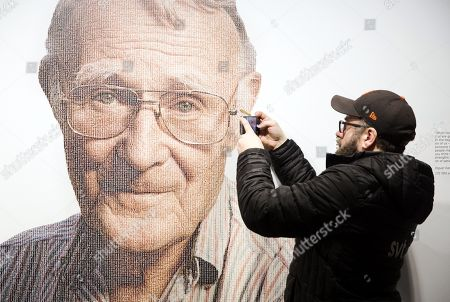 A visitor to the IKEA museum takes a photo with a mobile of a picture of Ingvar Kamprad, founder of Swedish multinational furniture retailer IKEA, in the entrance of the IKEA museum in Almhult, Sweden, 28 January 2018. Kamprad has died at an age of 91. The first ever IKEA store was opened in Almhult, and Kamprad grew up in the area.