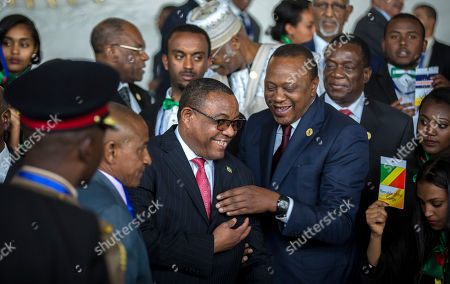 Stock Photo of Uhuru Kenyatta, Hailemariam Desalegn. Kenya's President Uhuru Kenyatta, center-right, laughs with Ethiopia's Prime Minister Hailemariam Desalegn, center-left, at the opening ceremony of the African Union summit in Addis Ababa, Ethiopia . The leaders of the United Nations and the African Union urged stronger international cooperation at the opening Sunday of the African Union summit in the Ethiopian capital, Addis Ababa