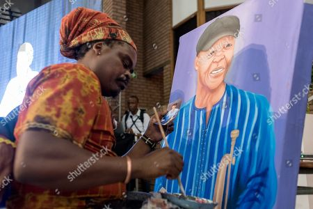 An artist paints a portrait of late South African musician, Hugh Masekela, during the official memorial for him in Johannesburg, South Africa, 28 January 2018. Friends and family  gathered to honour the legendary musician who died on 23 January after a long battle with prostate cancer.