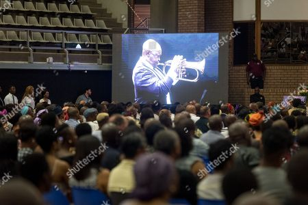 Stock Image of Late South African musician Hugh Masekela performing is projected onto a screen during the official memorial for him in Johannesburg, South Africa, 28 January 2018. Friends and family  gathered to honour the legendary musician who died on 23 January after a long battle with prostate cancer.