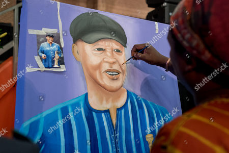 Stock Picture of An artist paints a portrait of late South African musician, Hugh Masekela, during the official memorial for him in Johannesburg, South Africa, 28 January 2018. Friends and family  gathered to honour the legendary musician who died on 23 January after a long battle with prostate cancer.