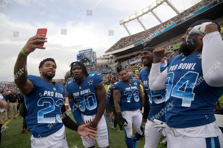 Chandler Jones, Darius Slay, Mike Daniels, Cameron Jordan, DeMarcus Lawrence. NFC defensive back Darius Slay (23), of the Detroit Lions, records with his phone before the NFL Pro Bowl football game, in Orlando, Fla. The AFC won 24-23. With him are defensive end DeMarcus Lawrence (90), of the Dallas Cowboys, defensive tackle Mike Daniels (76), of the Green Bay Packers, linebacker Chandler Jones (55), of the Arizona Cardinals, and defensive end Cameron Jordan (94), of the New Orleans Saints