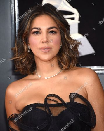 Liz Hernandez arrives at the 60th annual Grammy Awards at Madison Square Garden, in New York