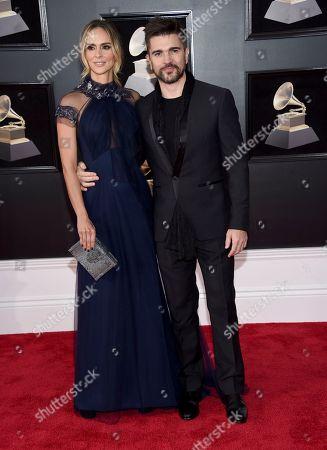 Karen Martinez, Juanes. Juanes, right, and Karen Martinez arrive at the 60th annual Grammy Awards at Madison Square Garden, in New York