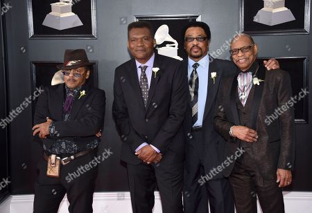 Robert Cray, second from left, and Hi Rhythm Section arrive at the 60th annual Grammy Awards at Madison Square Garden, in New York