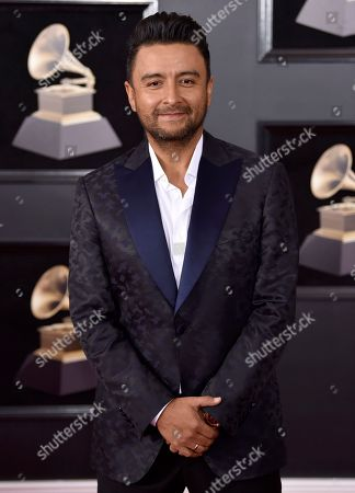 Alex Campos arrives at the 60th annual Grammy Awards at Madison Square Garden, in New York