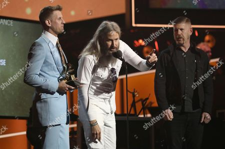 """Brann Dailor, Troy Sanders, Bill Kelliher. Brann Dailor, left, Troy Sanders, center, and Bill Kelliher, of Mastodon, accept the best metal performance award for """"Sultan's Curse"""" at the 60th annual Grammy Awards at Madison Square Garden, in New York"""