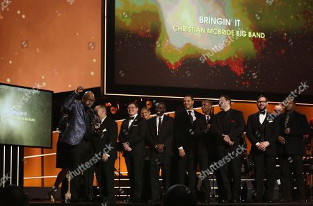 """Christian McBride, of Christian McBride Big Band, accepts the best large jazz ensemble album award for """"Bringin' It"""" at the 60th annual Grammy Awards at Madison Square Garden, in New York"""
