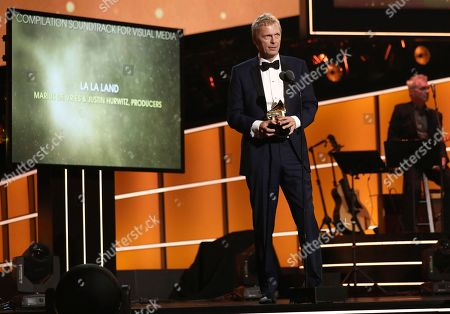 """Stock Image of Marius de Vries accepts the best compilation soundtrack for visual media award for """"La La Land"""" at the 60th annual Grammy Awards at Madison Square Garden, in New York"""