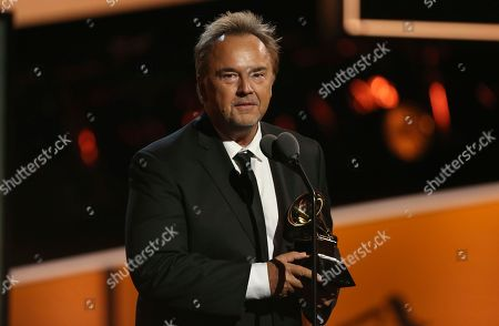 """Stock Image of Peter Kater accepts the best new age album award for """"Dancing On Water"""" at the 60th annual Grammy Awards at Madison Square Garden, in New York"""