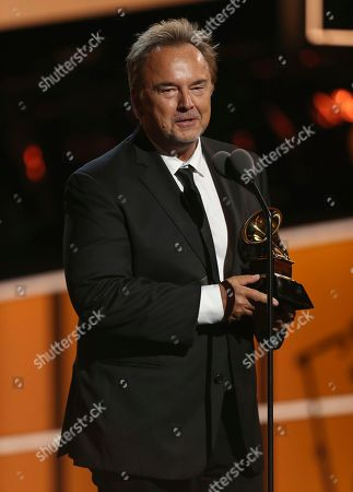"""Peter Kater accepts the best new age album award for """"Dancing On Water"""" at the 60th annual Grammy Awards at Madison Square Garden, in New York"""