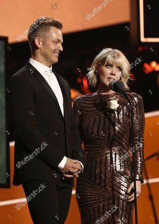 Bernie Herms, Natalie Grant. Bernie Herms, left, and Natalie Grant speak at the 60th annual Grammy Awards at Madison Square Garden, in New York