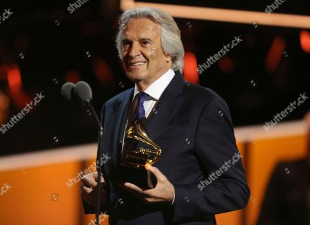 "John McLaughlin accepts the best improvised jazz solo award for ""Miles Beyond"" at the 60th annual Grammy Awards at Madison Square Garden, in New York"