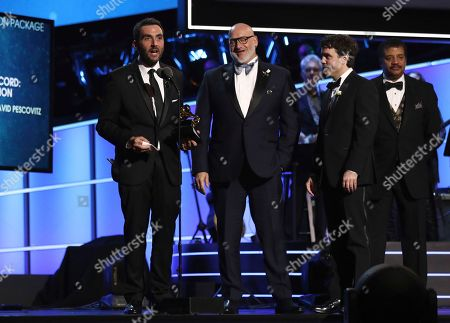 Stock Photo of Lawrence Azerrad, David Pescovitz, Timothy Daly. Lawrence Azerrad, from left, David Pescovitz, center, and Timothy Daly accept the best boxed or special limited edition package award for The Voyager Golden Record: 40th Anniversary Edition at the 60th annual Grammy Awards at Madison Square Garden, in New York