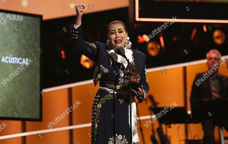 """Aida Cuevas accepts the best regional Mexican music album (including Tejano) award for """"Arriero Somos Versiones Acusticas"""" at the 60th annual Grammy Awards at Madison Square Garden, in New York"""