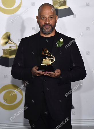 """Allen Hughes poses in the press room with the award for best music film for """"The Defiant Ones"""" at the 60th annual Grammy Awards at Madison Square Garden, in New York"""