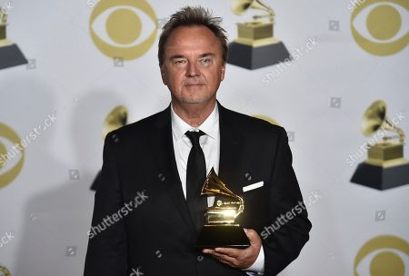 """Peter Kater poses in the press room with the best new age album award for """"Dancing On Water"""" at the 60th annual Grammy Awards at Madison Square Garden, in New York"""