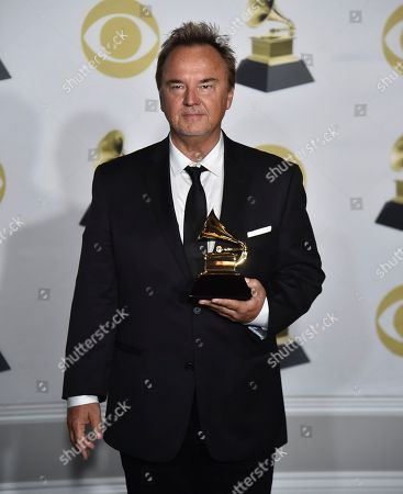 """Stock Picture of Peter Kater poses in the press room with the best new age album award for """"Dancing On Water"""" at the 60th annual Grammy Awards at Madison Square Garden, in New York"""