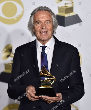 "John McLaughlin poses in the press room with the best improvised jazz solo award for ""Miles Beyond"" at the 60th annual Grammy Awards at Madison Square Garden, in New York"