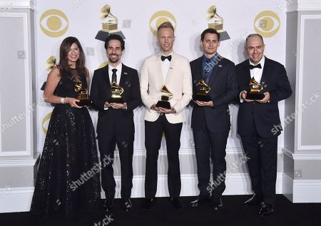 """From left, Stacey Mindich, Alex Lacamoire, Justin Paul, Benj Pasek, Pete Ganbarg pose in the press room with the best musical theater album award for """"Dear Evan Hansen"""" at the 60th annual Grammy Awards at Madison Square Garden, in New York"""