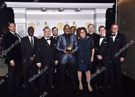 """Christian McBride Big Band poses in the press room with the best large jazz ensemble album award for """"Bringin' It"""" at the 60th annual Grammy Awards at Madison Square Garden, in New York"""