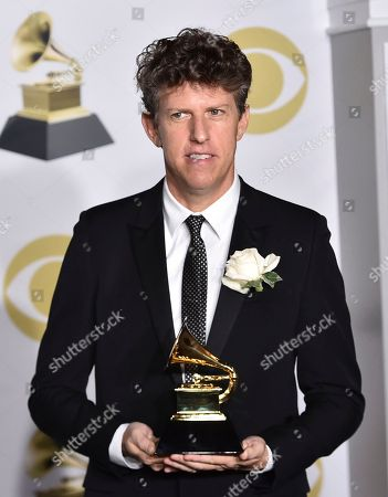 Greg Kurstin poses in the press room with the producer of the year, non-classical, award at the 60th annual Grammy Awards at Madison Square Garden, in New York